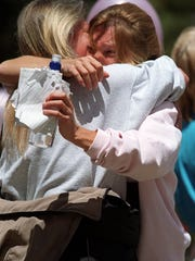 Terry Probyn, Jaycee Lee Dugard's mother, hugs a friend after speaking to marchers in 1991.