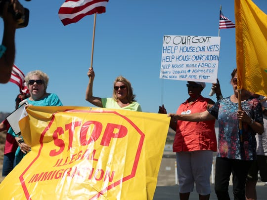Protesters have been gathering all morning in anticipation of the immigrant families arriving in Murrieta.
