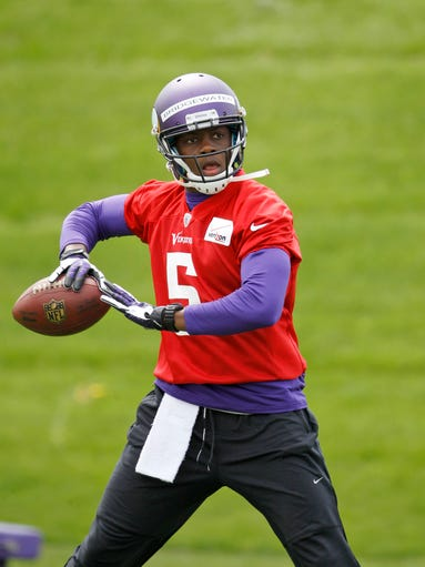 Quarterback Teddy Bridgewater drops back for a pass during Minnesota Vikings minicamp in Eden Prairie, Minn., Friday, May 16, 2014.   (AP Photo/Ann Heisenfelt)