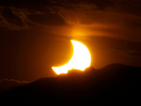 In this May 20, 2012, file photo, a solar eclipse is