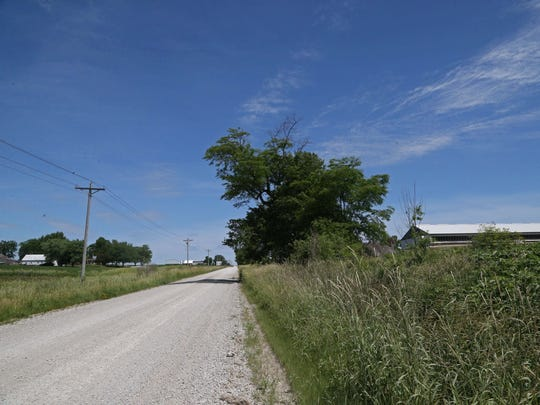 Gary Netser's home sits across the street from two small confined animal feeding operations (CAFOs) on Wednesday, June 8, 2016, in Iowa County. Nester's home is on the left, one of the confinements can be seen on the right.