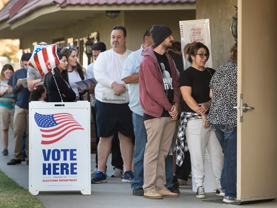 Voters wait their turn to enter Sierra Baptist Church