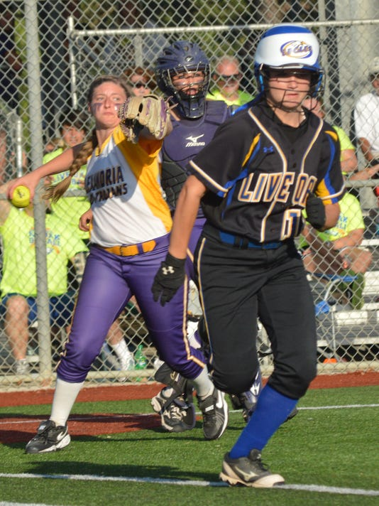 ANI Fri LHSAA ASH pitcher Carrie Boswell (back, left) throws to first for an out against Live Oak's Cameron Seals (12, right front) in the Class 5A game in the LHSAA State Softball Championships. -Melinda Martinez/mmartinez@thetowntalk.com