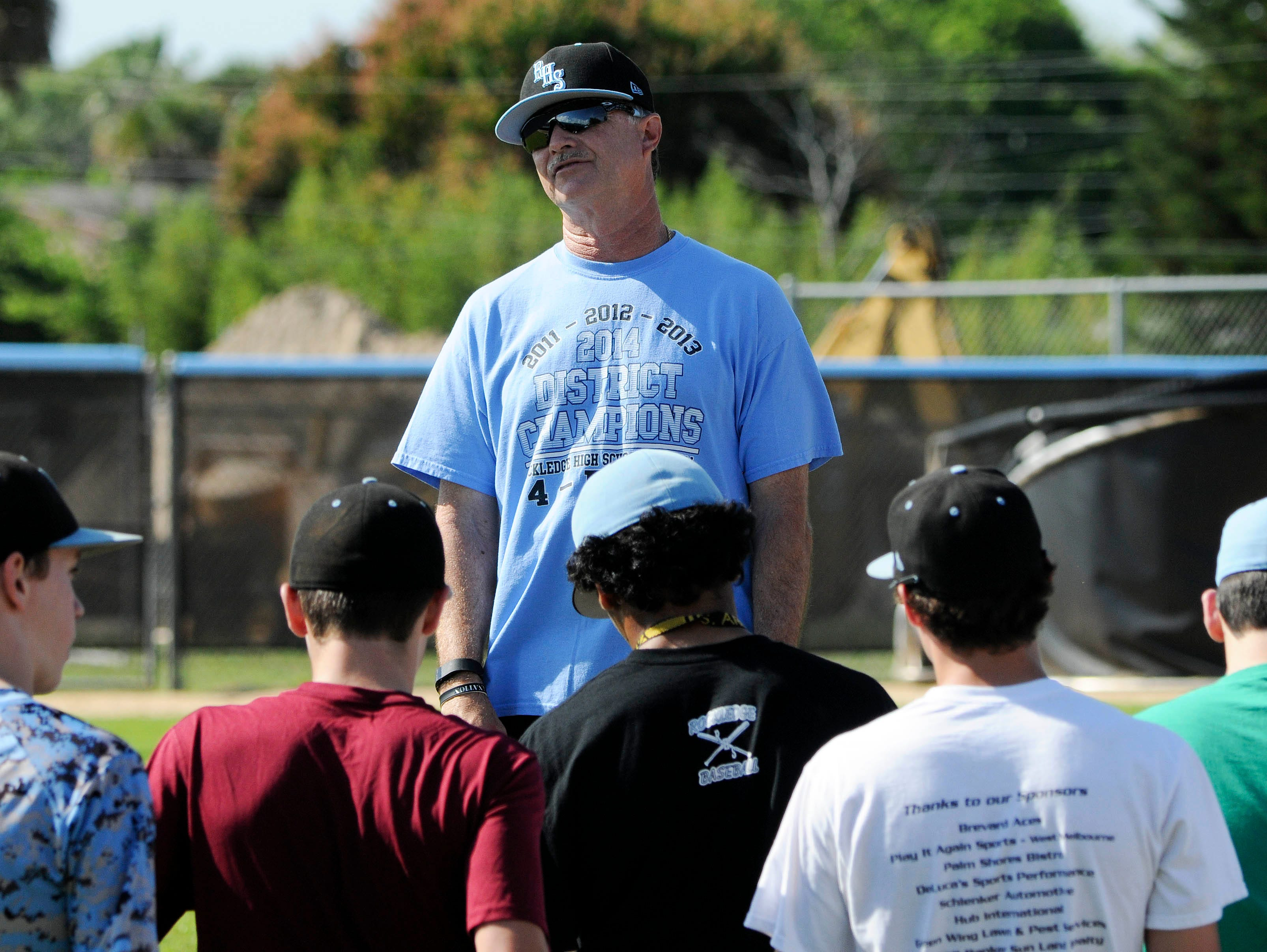 Rockledge baseball coach Greg Clayborne talks with his team during practice at Rockledge High School.