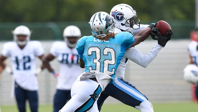 Tennessee Titans wide receiver Harry Douglas (83) pulls in a pass over Carolina Panthers cornerback Cole Luke (32) during a joint training camp practice at Saint Thomas Sports Park Wednesday, Aug. 16, 2017 in Nashville, Tenn..