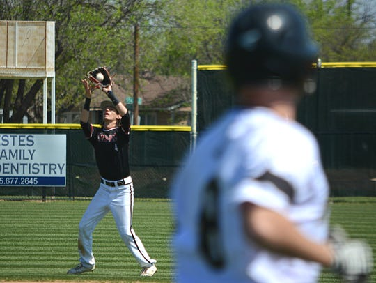 Keller Central's Julian Pokorny catches a pop up during
