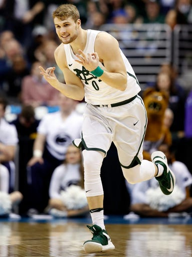 Michigan State  guard Kyle Ahrens celebrates a 3-point