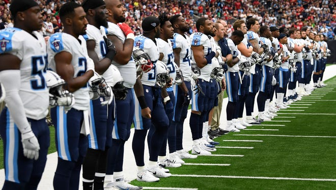 Titans line the sideline for the national anthem before their game against the Texans at NRG Stadium  Sunday, Oct. 1, 2017 in Houston , Texas.