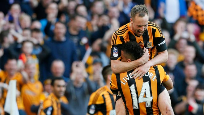 Hull City's David Meyler (top) celebrates with Jake Livermore after scoring against Sheffield United during their English FA Cup semi-final soccer match.