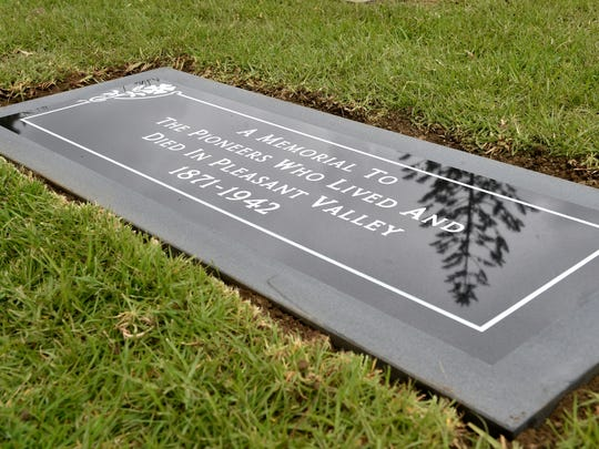 A new grave marker is unveiled at a common grave at Ivy Lawn in Ventura, where some of Camarillo's founding residents were moved from local plots several decades ago. Val Rains and Sherwood Milleman worked for many years to identify those buried at the site and were instrumental in getting a grave marker installed.