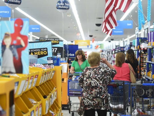 Shoppers search for back-to-school supplies at the Knoxville Walmart Supercenter on Walbrook Drive in West Knoxville during Tennessee's tax-free weekend, Friday, July 28, 2017.