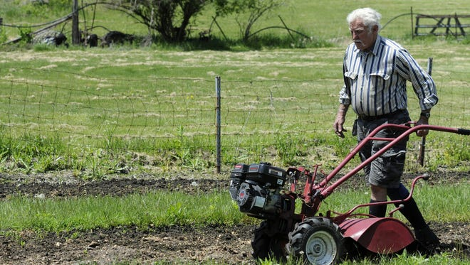 Bob Davidson of Green Horizons Organic Farm readies a field for planting on the farm in Pawling on Thursday. May 16, 2013.