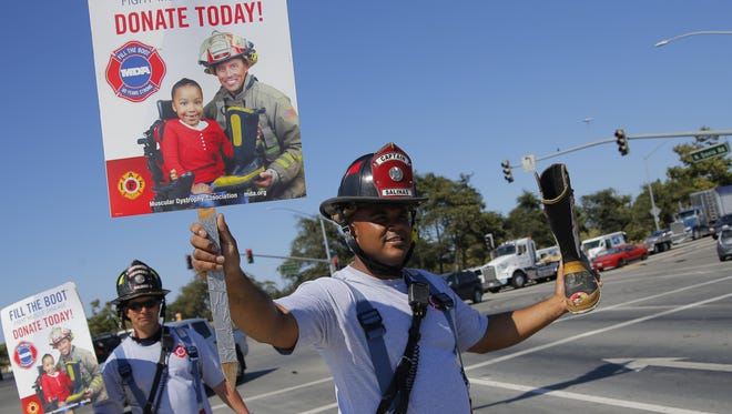 FILE: Salinas firefighters participate in MDA Fill the Boot fundraiser.
