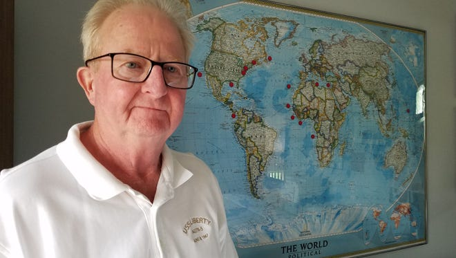 Clay Township veteran Jack Beattie stands in front of a world map depicting all the places he was while in the U.S. Navy on Monday, June 5, 2017.  He served on the American spy ship USS Liberty when it was attacked Israeli war planes and ships 50 years ago Thursday, June 8,