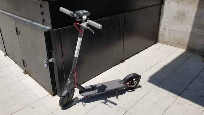 A Bird electric scooter sits on a sidewalk on East Georgia Street on Friday, June 15, 2018. The scooters launched in Indianapolis and Memphis on Friday.