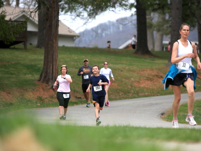 Runners and walkers participate in the 14th annual Conquer a Cove 5K and Health Walk on Sunday afternoon at Mount Pisgah Academy in Candler.  Runners wore bibs in honor of anyone affected by cancer, and participating cancer survivors were recognized.  Proceeds benefited The Hope Chest for Women, which provides assistance for WNC women diagnosed with breast or gynecologic cancer.  The top female finisher was Diane Wilson with a time of 21:18.4, and the top male finsiher was Gary Curran with 18:17.1. -4-6-14 Colby Rabon (colbyrabon@gmail.com)