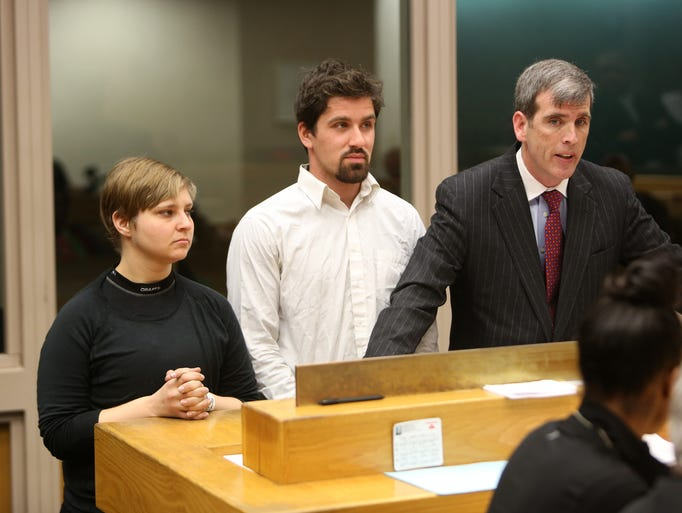 Marcella Largess, of Baltimore, and Nima Shahidi, of Fallston, Md., stand with their lawyer, William Gallagher, during their arraignment at the Hamilton County Justice Center on Wednesday morning.