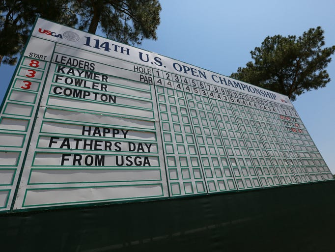 """A view of the 18th green leader board with """"Happy Father's Day from USGA"""" during the final round of the 2014 U.S. Open on June 15, 2014, at Pinehurst."""