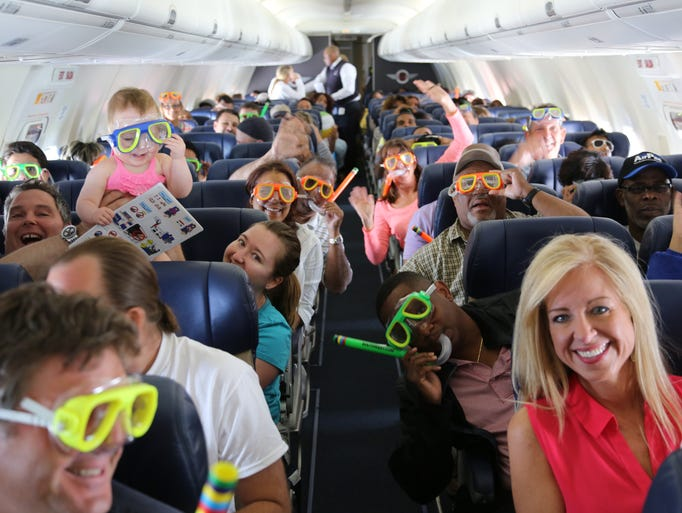 Passengers don complimentary snorkel gear that Southwest handed out on its second-ever international flight -- which flew from BWI to Montego Bay, Jamaica, on July 1, 2014.