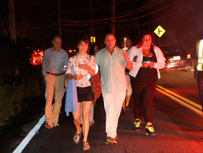 """Kathryn Erbe from Law and Order: Criminal Intent and Allen Roskoff, President of the Jim Owles Liberal Democratic Club, lead a """"Candles for Clemency"""" walk towards Gov. Andrew Cuomo's residence, Sept. 6, 2014 in New Castle. Over a 100 New Yorkers gathered for the vigil to urge Gov. Andrew Cuomo to grant clemency to even one of the 55,000 men and women imprisoned in New York State."""