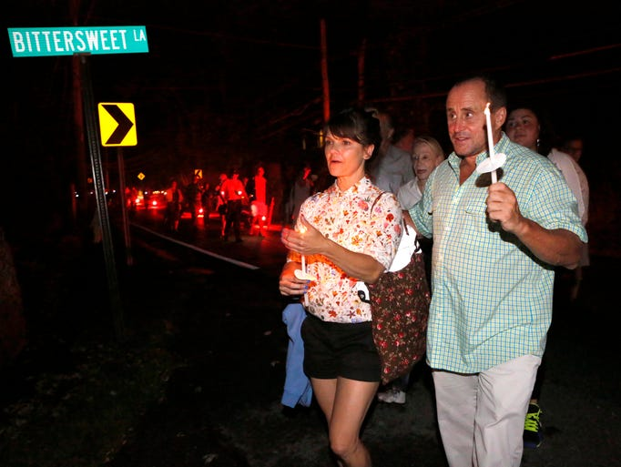 """Kathryn Erbe from Law and Order: Criminal Intent and Allen Roskoff, President of the Jim Owles Liberal Democratic Club, lead a """"Candles for Clemency"""" walk towards Gov. Andrew Cuomo's residence, Sept. 6, 2014 in New Castle. Over 100 New Yorkers gathered for the vigil to urge Gov. Andrew Cuomo to grant clemency to even one of the 55,000 men and women imprisoned in New York State."""