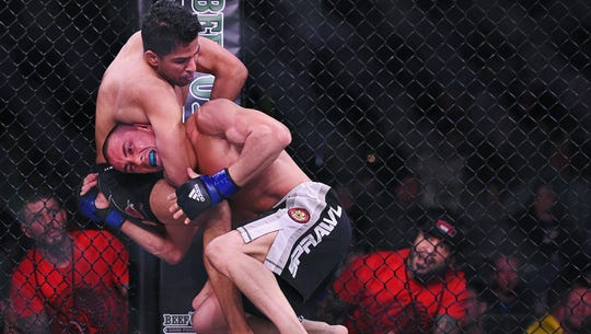 Matt Lopez (left) fights Eli Rinn during the Resurrection