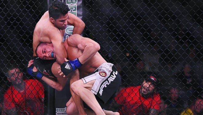 Matt Lopez (left) fights Eli Rinn during the Resurrection Fighting Alliance 37 mixed martial arts event Friday, April 15, 2016 at the Sanford Pentagon in Sioux Falls.