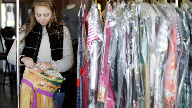 Maddie Tesch, a senior at Appleton North High School in the Willems Student Marketing Team, helps organize dresses while preparing for her upcoming Hello Beautiful one-day resale dress shop to raise money for Make-A-Wish Wednesday, April 11, 2018, in Appleton, Wis. The event will be held Saturday at the Radisson Paper Valley Hotel from 8 a.m. to 8 p.m. in connection with Appleton Downtown Inc.'s Spring Into Style Ladies' Day.  Danny Damiani/USA TODAY NETWORK-Wisconsin