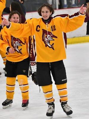 Senior forward Natalie Vaitas celebrates after helping lift Mercy to the Division 1 hockey championship Saturday at the Novi Ice Arena.