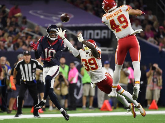 Kansas City Chiefs cornerback Jacoby Glenn (39) breaks up a pass intended for Houston Texans wide receiver DeAndre Hopkins (10) during the second half of an NFL football game, Sunday, Oct. 8, 2017, in Houston. (AP Photo/Eric Christian Smith)
