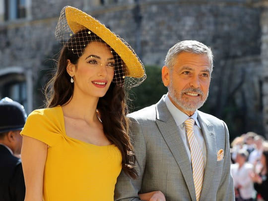 Geroge Clooney and wife Amal arrive for Prince Harry and Meghan Markle's wedding.