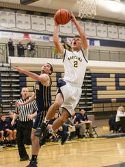 Hartland's Connor Harris drives to the basket against
