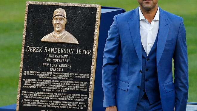 NEW YORK, NY - MAY 14: Former New York Yankees great, Derek Jeter stands by his plaque during a pregame ceremony honoring Jeter and retiring his number 2 at Yankee Stadium on May 14, 2017 in New York City. (Photo by Rich Schultz/Getty Images)