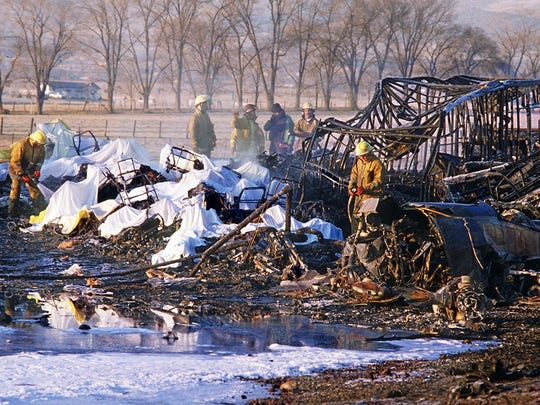 Marilyn Newton /RGJ file Firefighters go over the wreckage of the Galaxy Airlines plane that crashed in the early morning hours of Jan. 21, 1985, on Virginia Street just south of Del Monte Lane.
