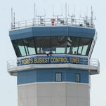 """A """"World's Busiest Control Tower"""" banner hangs from the air traffic control tower at Wittman Regional Airport during EAA AirVenture 2012."""