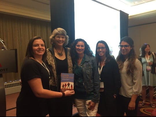 Teachers Carey Anne Hendershot, Sharon Rickman, Blair Alber, and Meagan Menza are pictured with author Cathy Seeley (second from left), who is a past president of the National Council for Teachers of Mathematics.