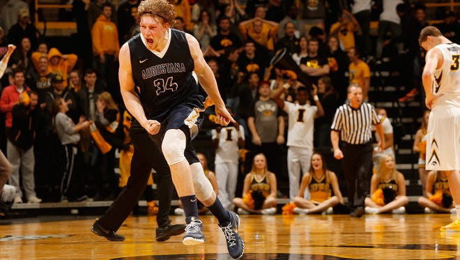 Augustana forward Daniel Jansen (34) celebrates after hitting a game-winning shot as Iowa Hawkeyes center Adam Woodbury (34) stands dejected on the court in an exhibition game at Carver-Hawkeye Arena in Iowa City on Friday.