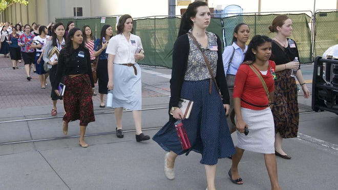 In this 2013 photo, sister missionaries are evacuated from Temple Square in Salt Lake City, to be checked out by emergency personal, after a gas leak was detected in the South Visitors Center.