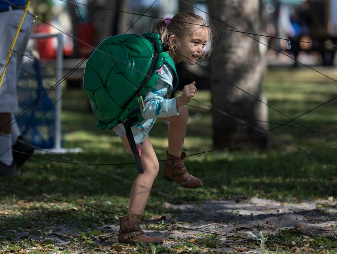 Tauni Greer, 7, goes through an obstacle course while