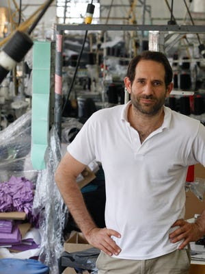 This April 2012 file photo shows American Apparel founder Dov Charney at the company's factory in downtown Los Angeles.
