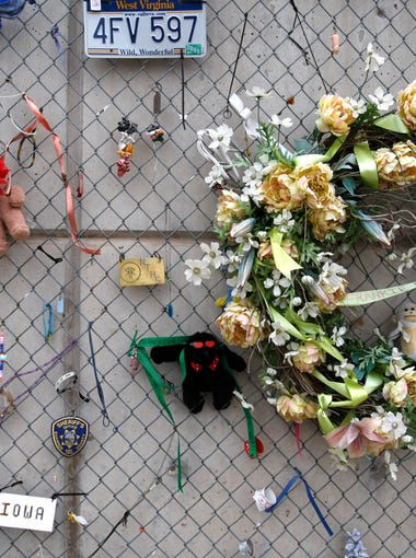 Mementos are left on a fench at the Oklahoma City National Memorial in Oklahoma City, Ok., Tuesday, March 16, 2010. The memorial honors the 168 victims of the April 19, 1995 truck bombing of the Alfred P. Murrah Federal Building. (AP Photo/Carlos Osorio)