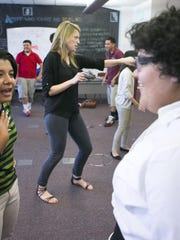 ASU Preparatory Academy senior Donna Flores, 18, left,