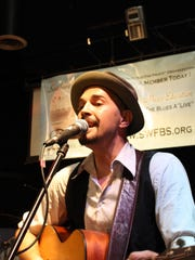 """Ryan """"Little Eddie"""" Bladen sings at the 2013 Southwest Florida Blues Society International Blues Challenge regional qualifier. Bladen won the competition's solo act category last year."""