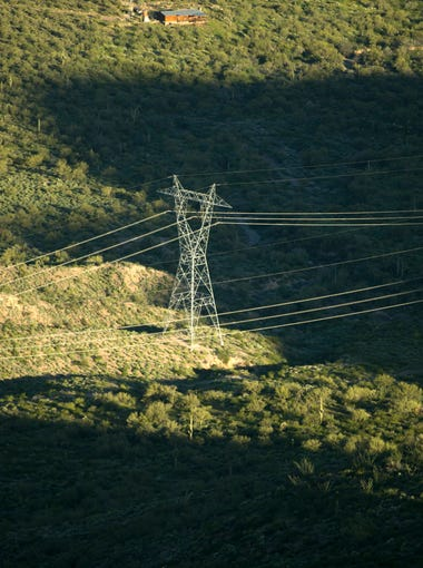 A 500 KV transmission line is seen near New River during an APS helicopter flight to survey APS transmission lines to make sure they are in good condition on Wednesday, March 15, 2017. APS does an annual survey of all of their over 6,000 miles of transmission lines, the majority by helicopter.