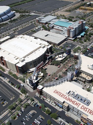 An aerial view of State Farm Stadium, Gila River Arena and the Westgate Entertainment District in Glendale.