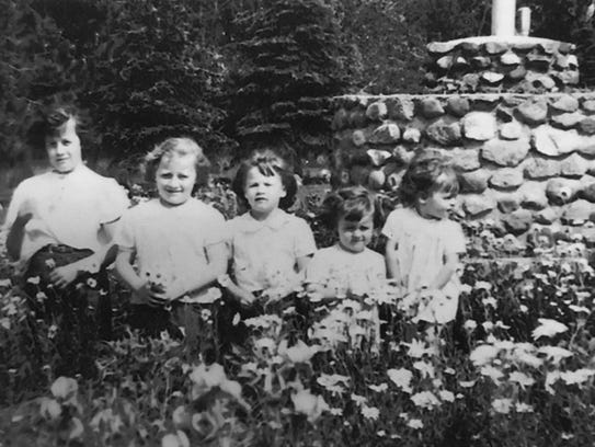 Pat (Steman) Fitzharris (second from right) posed with