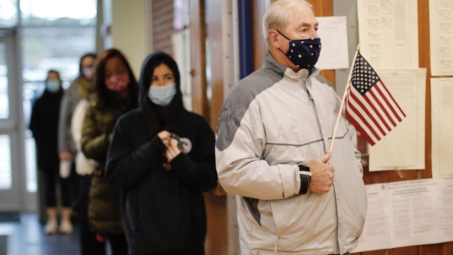 Voters line up at the polls early in Scituate to cast their ballots in the General Election on Tuesday, November 3, 2020. Greg Derr/The Patriot Ledger