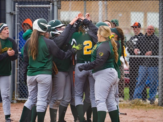 Pennfield's softball team cheers around Alexa Stephenson