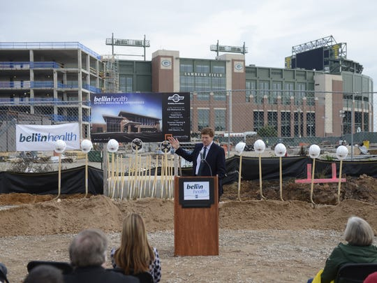 Green Bay Packers President/CEO Mark Murphy gestures toward Lodge Kohler, in background, during the Bellin Health Sports Medicine & Orthopedics ground breaking Thursday in the Titletown District. Oct. 6, 2016.