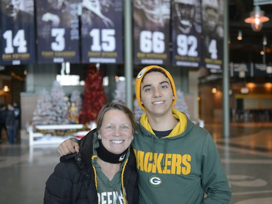 Gabriel Kune Piragine of Taubate, Brazil, poses with his host, Kim Raymond of Neenah, on Friday at Lambeau Field.